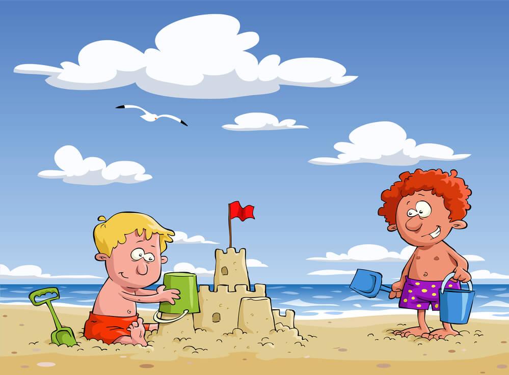 dzieci na plaży domki z piasku